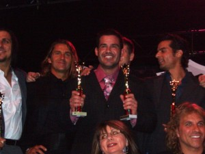 Charles Paz with both his trophies, which were presented by Mr. Romance 2008 Chris Winters